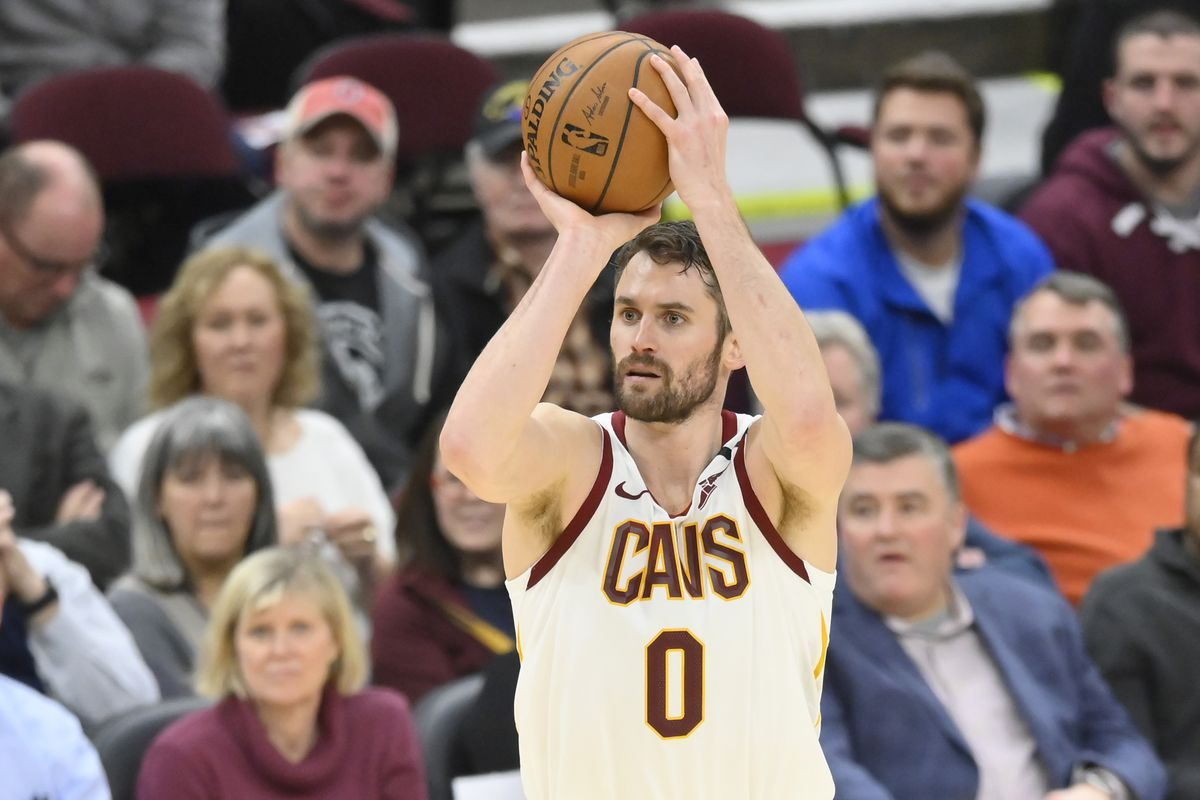 Cleveland Cavaliers forward Kevin Love shoots a three-point basket in the fourth quarter against the Toronto Raptors at Rocket Mortgage FieldHouse.
