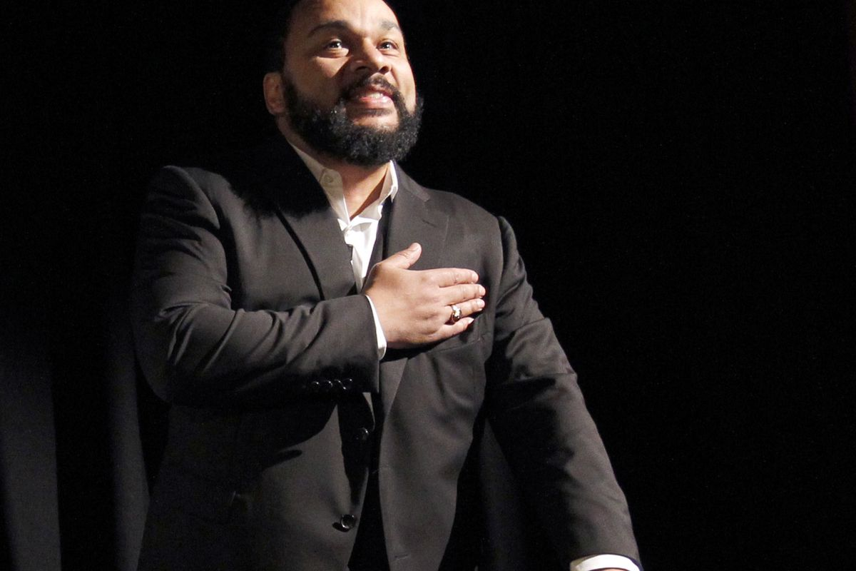 Dieudonné M'bala M'bala performs the quenelle, a gesture he popularized referencing the Nazi salute.