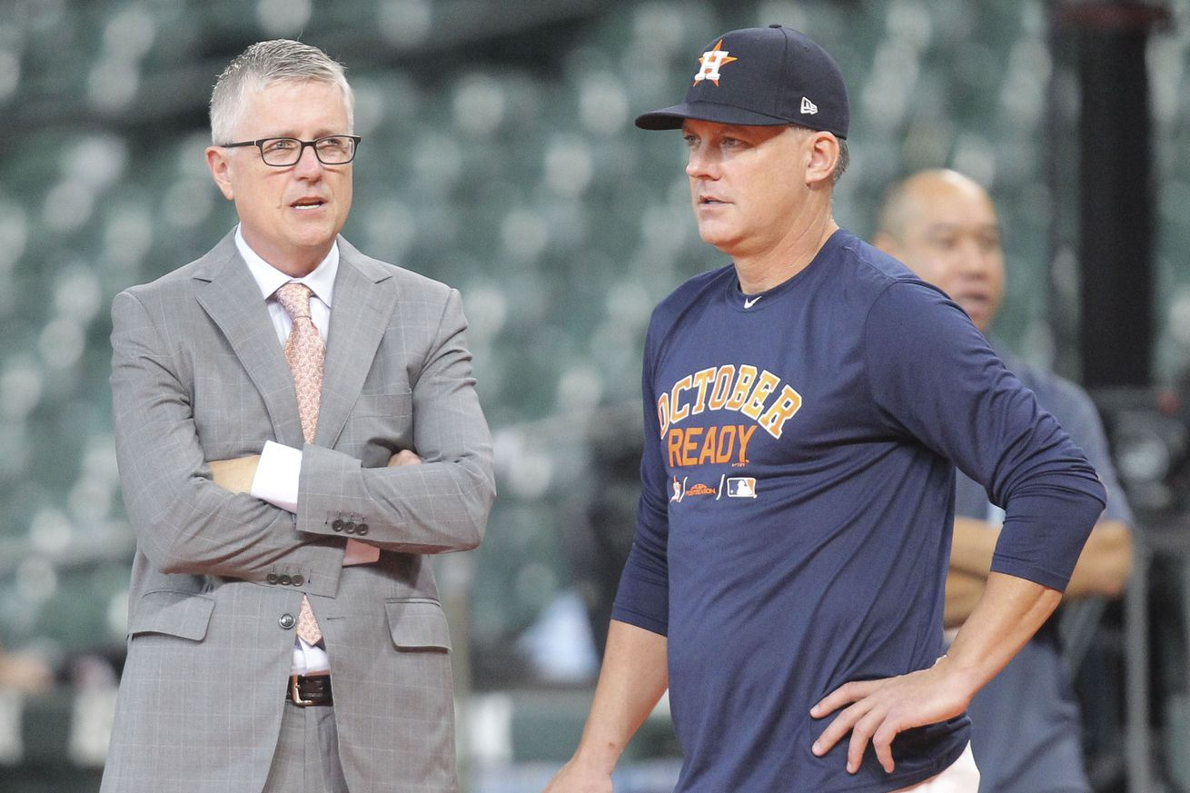 Astros GM Jeff Luhnow discusses his world domination plan with manager A.J. Hinch. The world trembles.