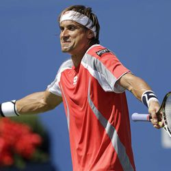 Spain's David Ferrer reacts while playing Serbia's Novak Djokovic during a semifinal match at the 2012 US Open tennis tournament,  Sunday, Sept. 9, 2012, in New York.
