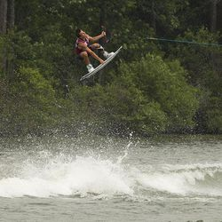 Harley Clifford catches air during the 2017 Supra Pro Wakeboard Tour event at Oak Mountain State Park near Birmingham, Alabama.