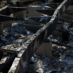 The twisted steel remains of Bob and Anne Noble's manufactured home is pictured in the Mountain View Estates neighborhood, a manufactured home community for seniors in Talent, Ore., on Saturday, Sept. 19, 2020, after being nearly completely burned by the Almeda Fire.
