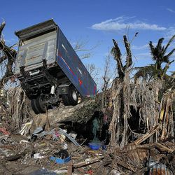 Damage shows in Tacloban, Tuesday, Nov. 19, 2013, following Typhoon Haiyan in the Philippines.