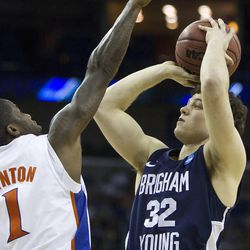 BYU's Jimmer Fredette hits a jump shot during the Cougars' NCAA Tournament game against Florida in New Orleans on March 24, 2011. Fredette, now with the Sacramento Kings, is suing Utah-based clothing company Black Clover Enterprises for allegedly failing to pay him and using his name and likeness for profit.