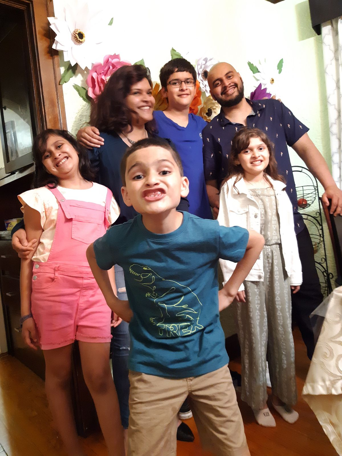 """Jesus Alberto """"Beto"""" Lopez Gutierrez (top right) with his sister Mariela Lopez and nieces and nephews before he was deported."""
