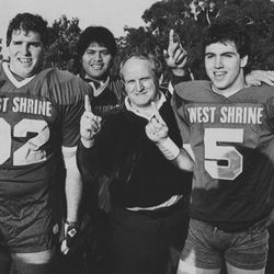 BYU head football coach LaVell Edwards stands with Kyle Morrell (5) after practice in the East-West Shrine game Jan. 2, 1985.
