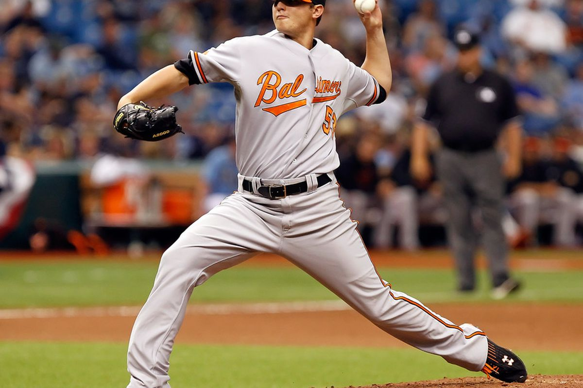 Pitcher Zach Britton of the Baltimore Orioles pitches against the Tampa Bay Rays during the game at Tropicana Field on April 3, 2011 in St. Petersburg, Florida.  (Photo by J. Meric/Getty Images)