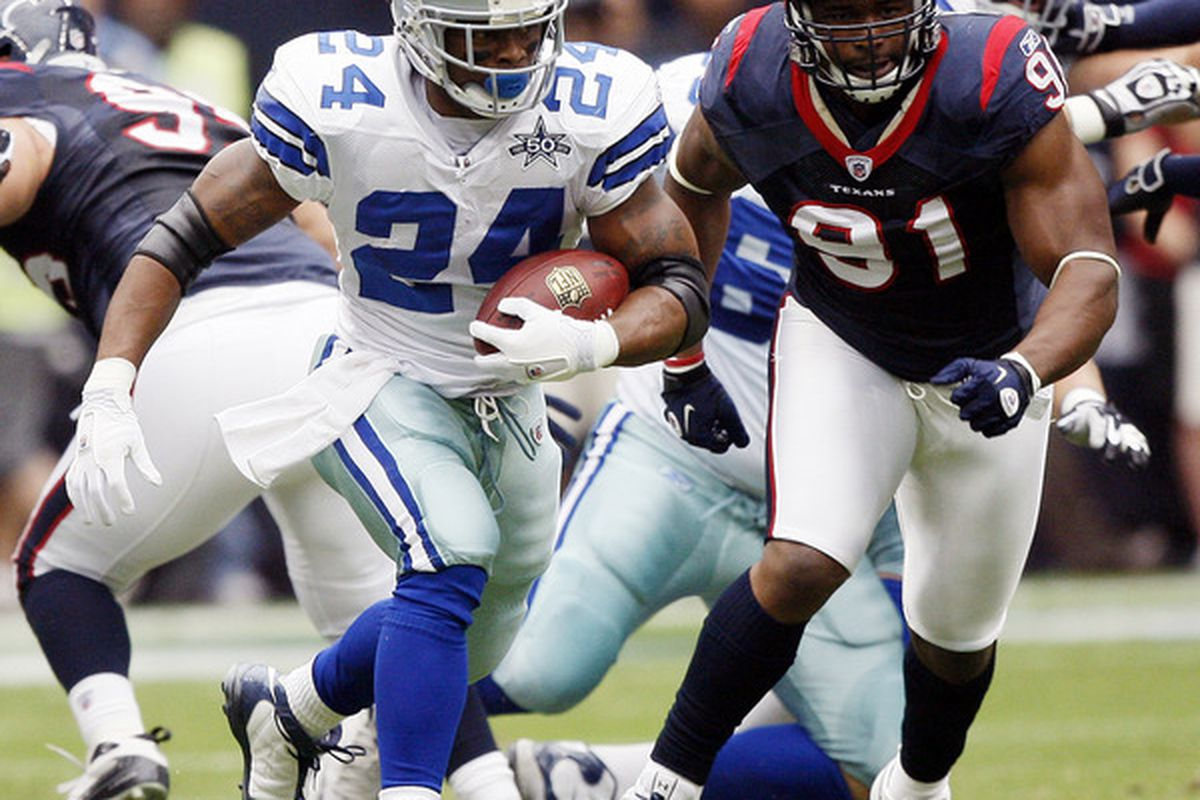 HOUSTON - SEPTEMBER 26:  Running back Marion Barber #24 of the Dallas Cowboys rushes past defensive tackle Amobi Okoye #91 of the Houston Texans at Reliant Stadium on September 26 2010 in Houston Texas.  (Photo by Bob Levey/Getty Images)
