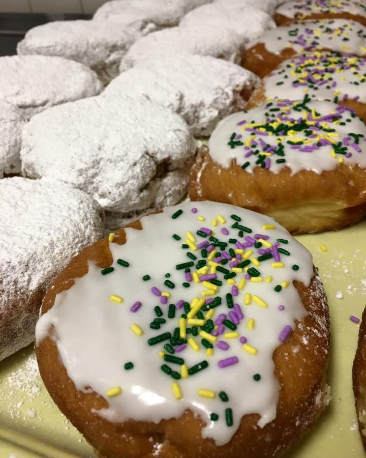 Powdered sugar paczki and glaze paczki with mardi gras sprinkles at Avon Donuts.