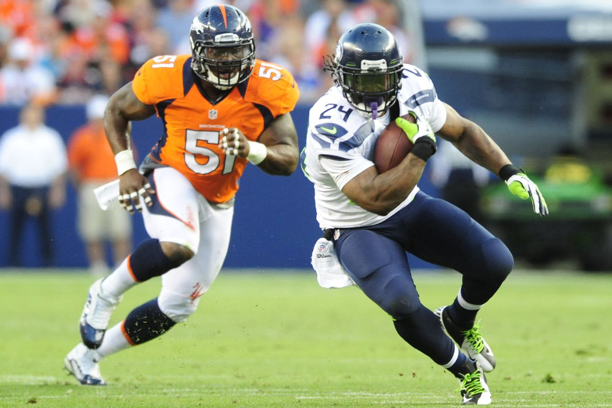 Aug 18, 2012; Denver, CO, USA;  Seattle Seahawks running back Marshawn Lynch (24) is pursued by Denver Broncos linebacker Joe Mays (51) in the first  quarter at Sports Authority Field.  Mandatory Credit: Byron Hetzler-US PRESSWIRE