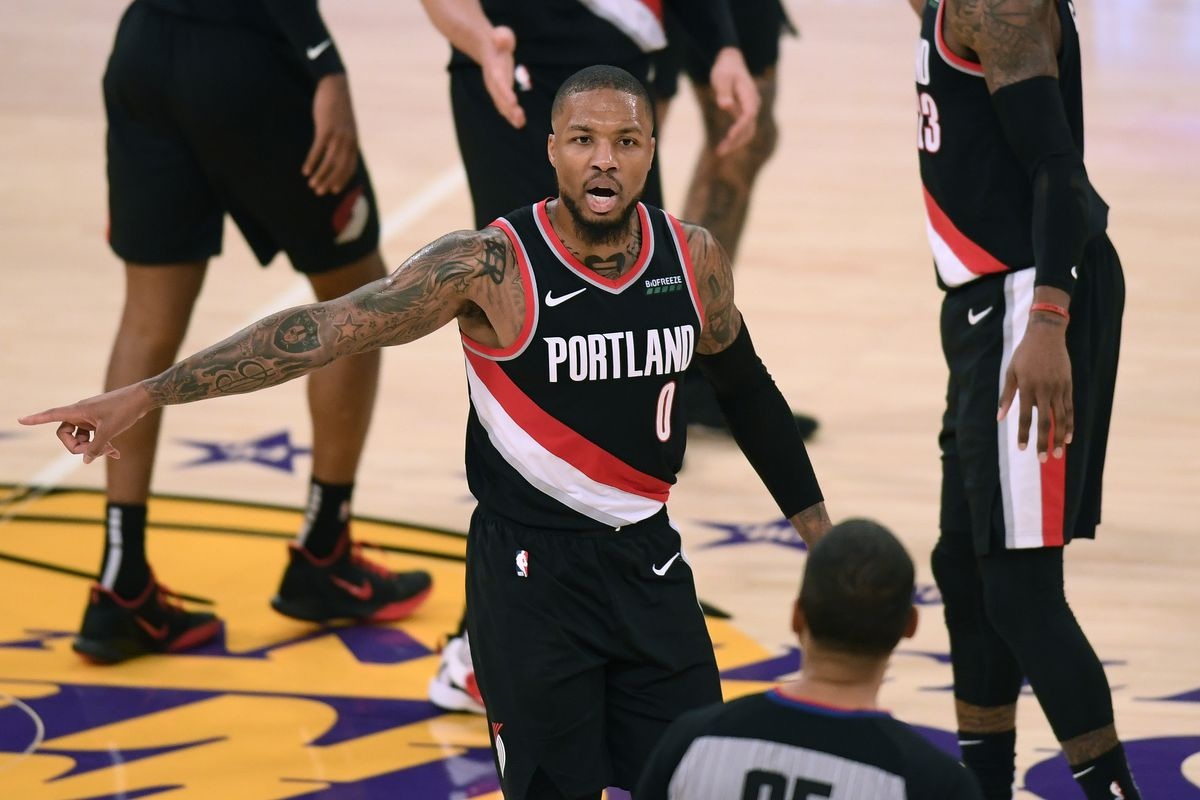 Damian Lillard of the Portland Trail Blazers argues with referee Nate Green during a 115-107 Trail Blazer win over the Los Angeles Lakers at Staples Center on December 28, 2020 in Los Angeles, California.