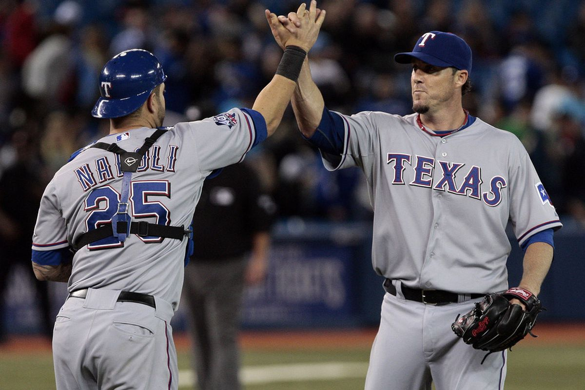 TORONTO, CANADA - APRIL 30: Mike Napoli #25 and Joe Nathan #36 of the Texas Rangers celebrate the win against the Texas Rangers during MLB action at the Rogers Centre April 30, 2012 in Toronto, Ontario, Canada.  (Photo by Abelimages/Getty Images)