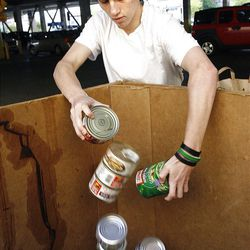 Chris Alegre, 16, of Park City volunteers his Saturday morning by unloading donated canned food for the Utah Food Bank at Walmart in Salt Lake City on Saturday, Sept. 29, 2012.  Hunger Action Month in Utah culminated with this statewide food drive at Walmart locations throughout the state.
