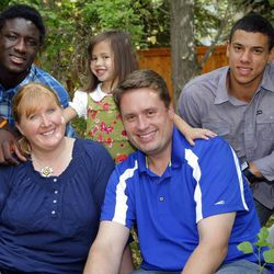 The Gerlach family at home on Monday, Sept. 10, 2012. Mom and Dad are Kim and Rob, front, Ibrahim, left, Clara, center, and Ecum, right. The Gerlachs since adopted another girl.
