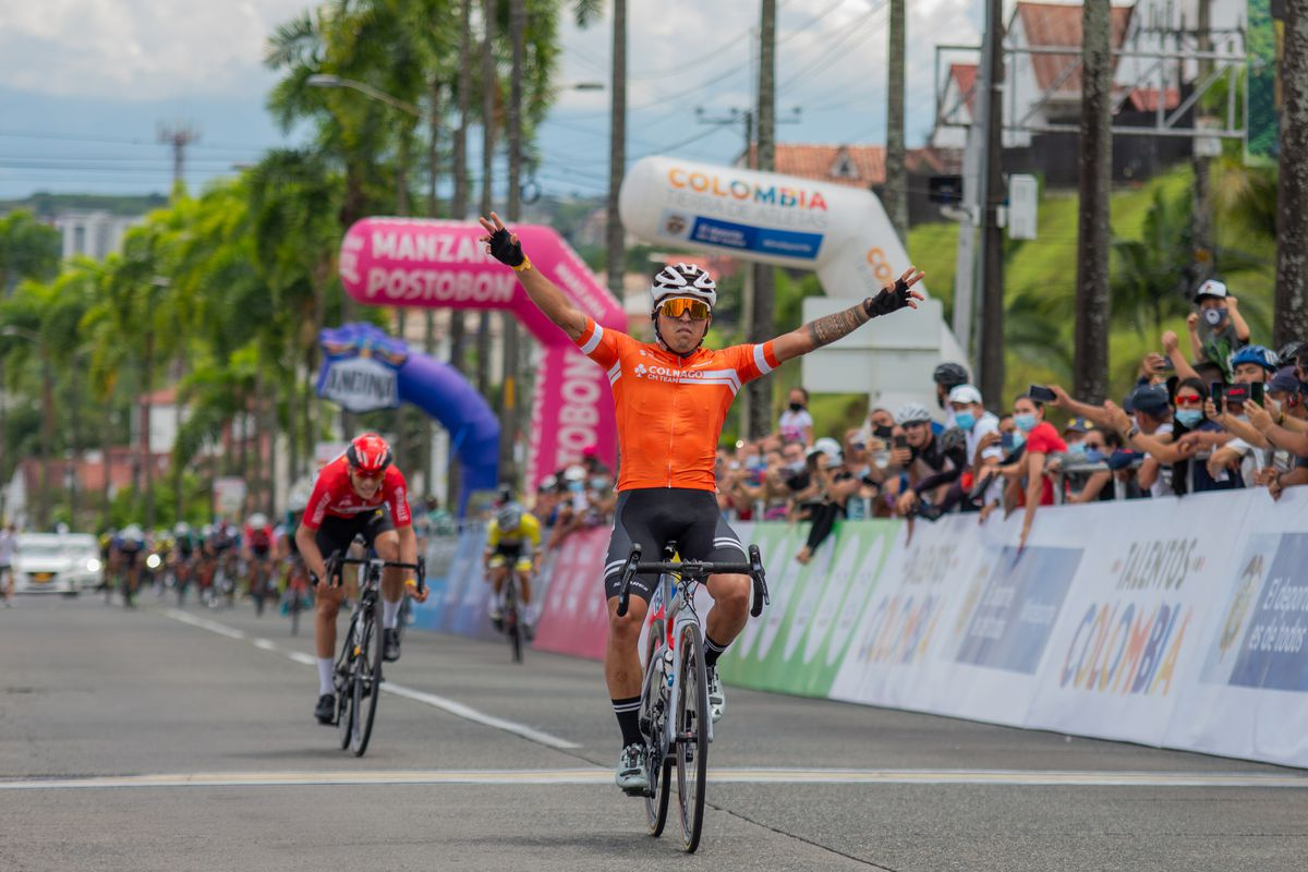Cyclists Juan Esteban Guerrero of Colnago CM Team celebrating victory during the SUB-23 Qualifiers Colombian National Road Race Bicycle Championship in Pereira, Colombia on June 19, 2021.
