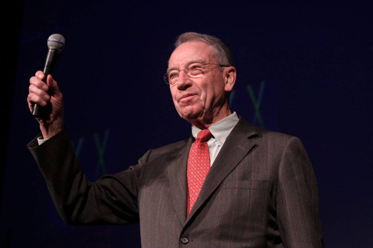Sen. Chuck Grassley (R-IA) prepares to bludgeon patent trolls with a microphone.