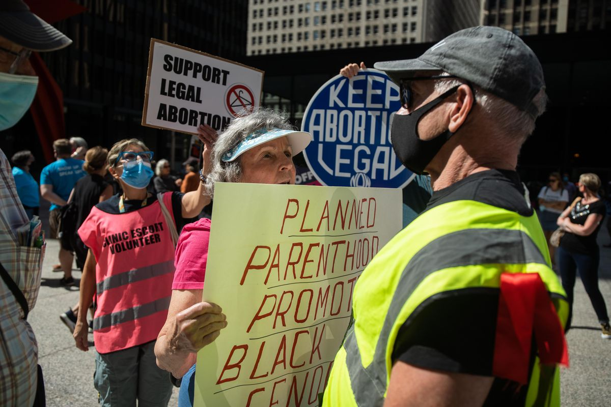 """Mary Ann Cronauer, a member of Pro-Life Action League, has an argument with a marshal during the """"Bans Off My Body"""" rally Friday afternoon at Federal Plaza in the Loop."""