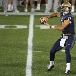 Navy quarterback Perry Olsen (11) throws during the second half of an NCAA college football game against BYU, Monday, Sept. 7, 2020, in Annapolis, Md.