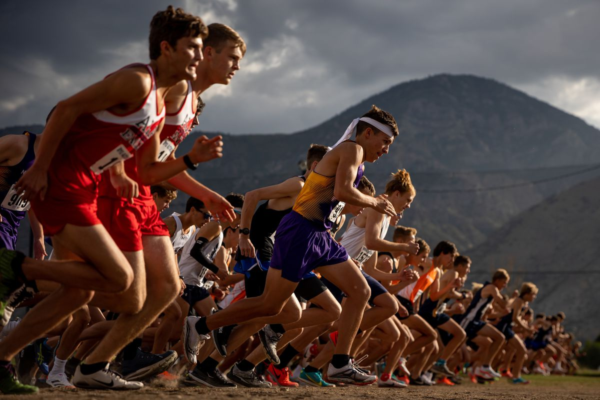 Runners start off in the varsity boys race of the 2021 BYU Autumn Classic at Timpanogos Golf Club in Provo.