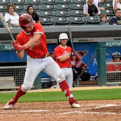 Cole Barr swings at a pitch that will ultimately end up in the right-center gap for a three-run triple. The junior's big hit would prove to be the game-winner for the red team.