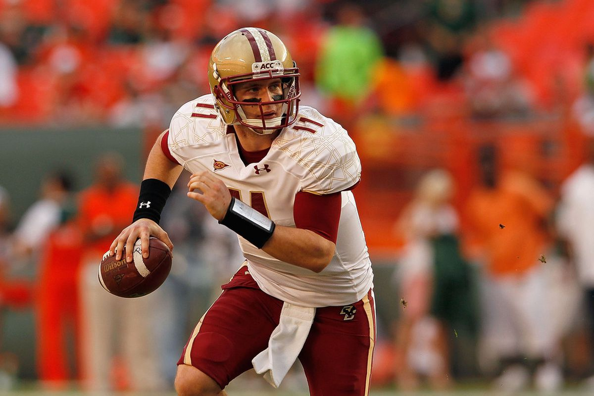 MIAMI GARDENS, FL - NOVEMBER 25: Chase Rettig #11 of the Boston College Eagles looks to pass during a game against the Miami Hurricanes at Sun Life Stadium on November 25, 2011 in Miami Gardens, Florida.  (Photo by Mike Ehrmann/Getty Images)