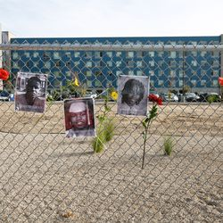 Pictures of African Americans that had lost their lives are displayed at the Say Their Names Memorial in Salt Lake City on Saturday, Sept. 26, 2020.