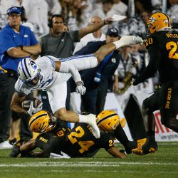 Brigham Young wide receiver Neil Pau'u, top, gets tackled by the Arizona State defense during an NCAA college football game at LaVell Edwards Stadium in Provo on Saturday, Sept. 18, 2021.