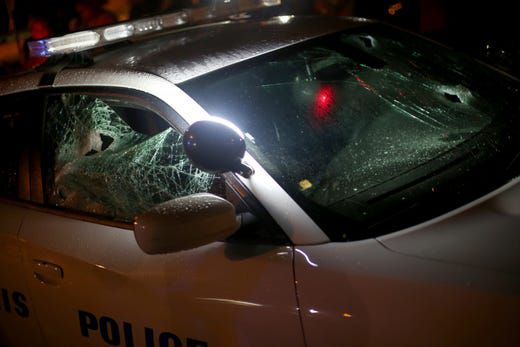 A Memphis police car with its windows smashed in at the scene of an officer-involved shooting in Frayser.