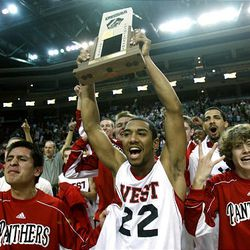 West's Chris Barnes (22) and the rest of the West Panthers celebrate their win over Provo. It was West's first boys basketball state title since 1975.