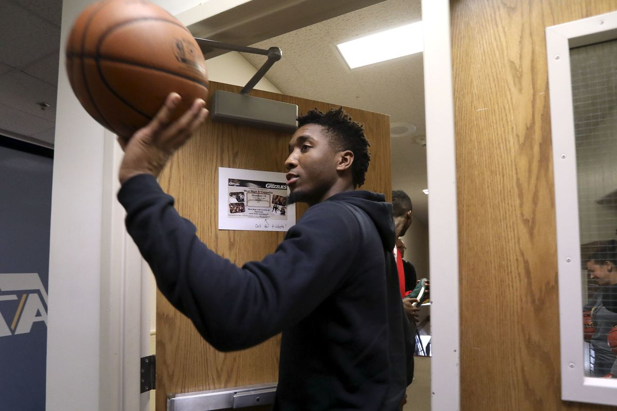 Utah Jazz guard Donovan Mitchell throws a signed basketball to a student at West High School in Salt Lake City on Tuesday, Oct. 9, 2018.