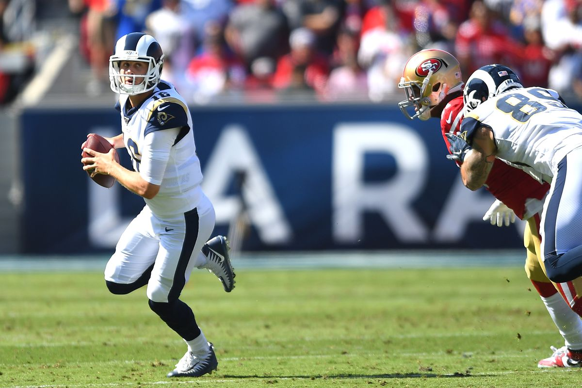 Quarterback Jared Goff of the Los Angeles Rams looks to pass in the game against the San Francisco 49ers at Los Angeles Memorial Coliseum on October 13, 2019 in Los Angeles, California.