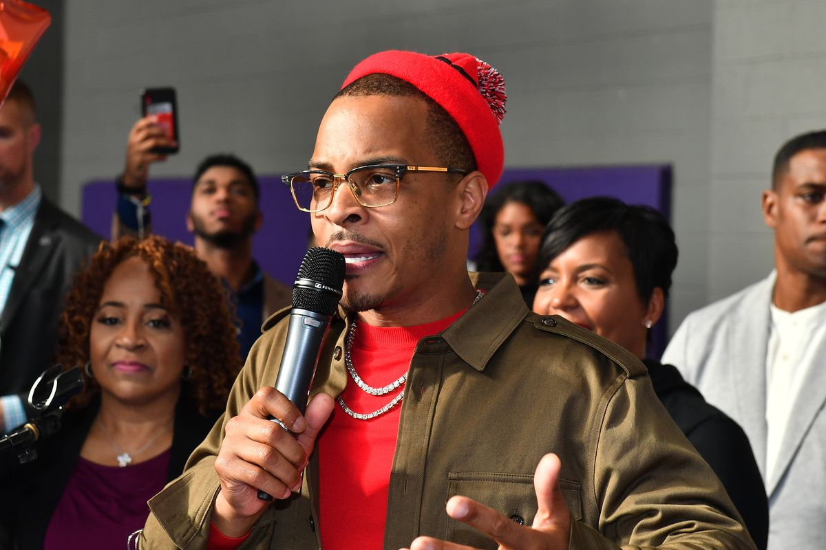 T.I. speaking into a microphone.