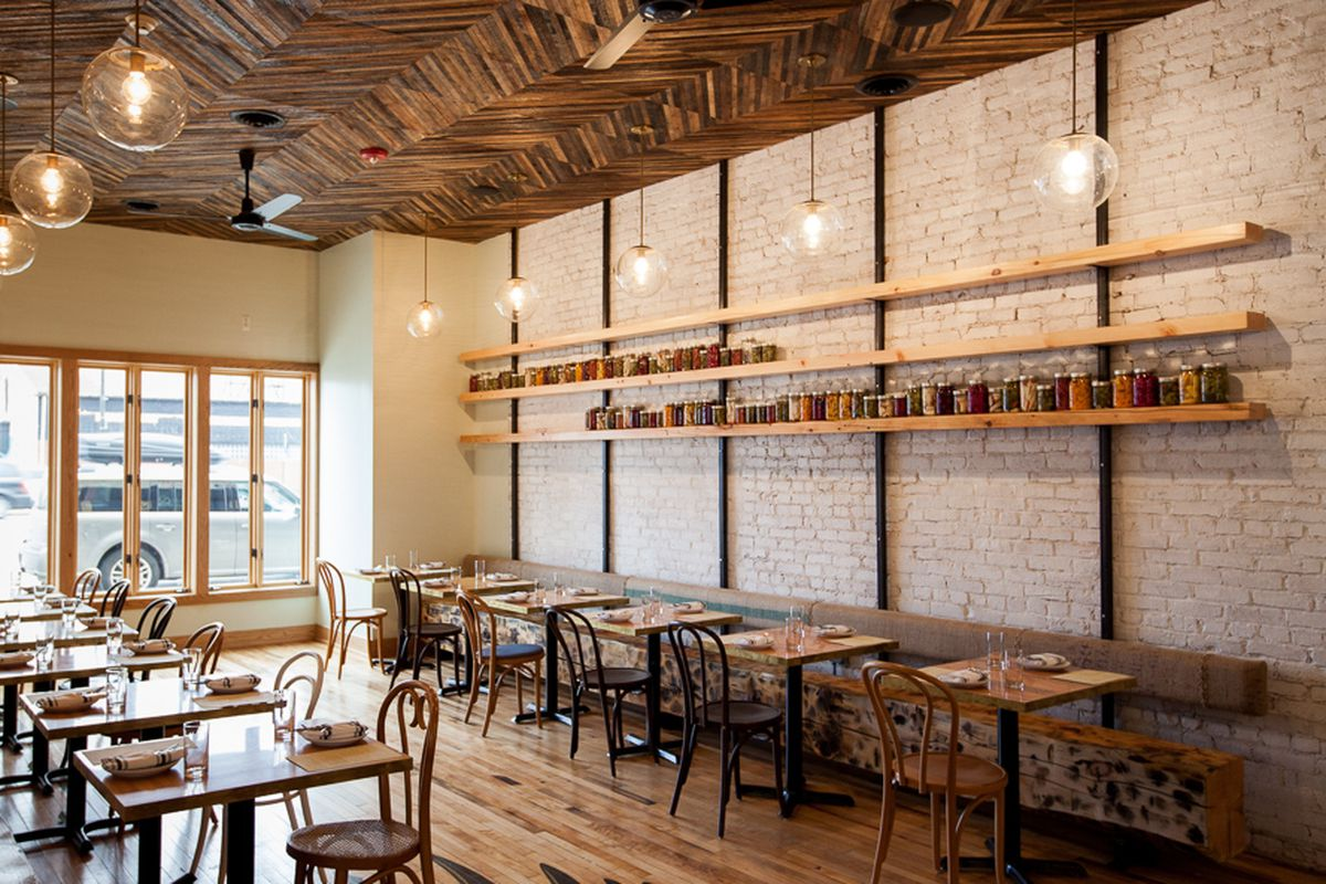 Chef Josh Stockton's menu features many house-made pickled products, some of which are displayed on the restaurant's walls.