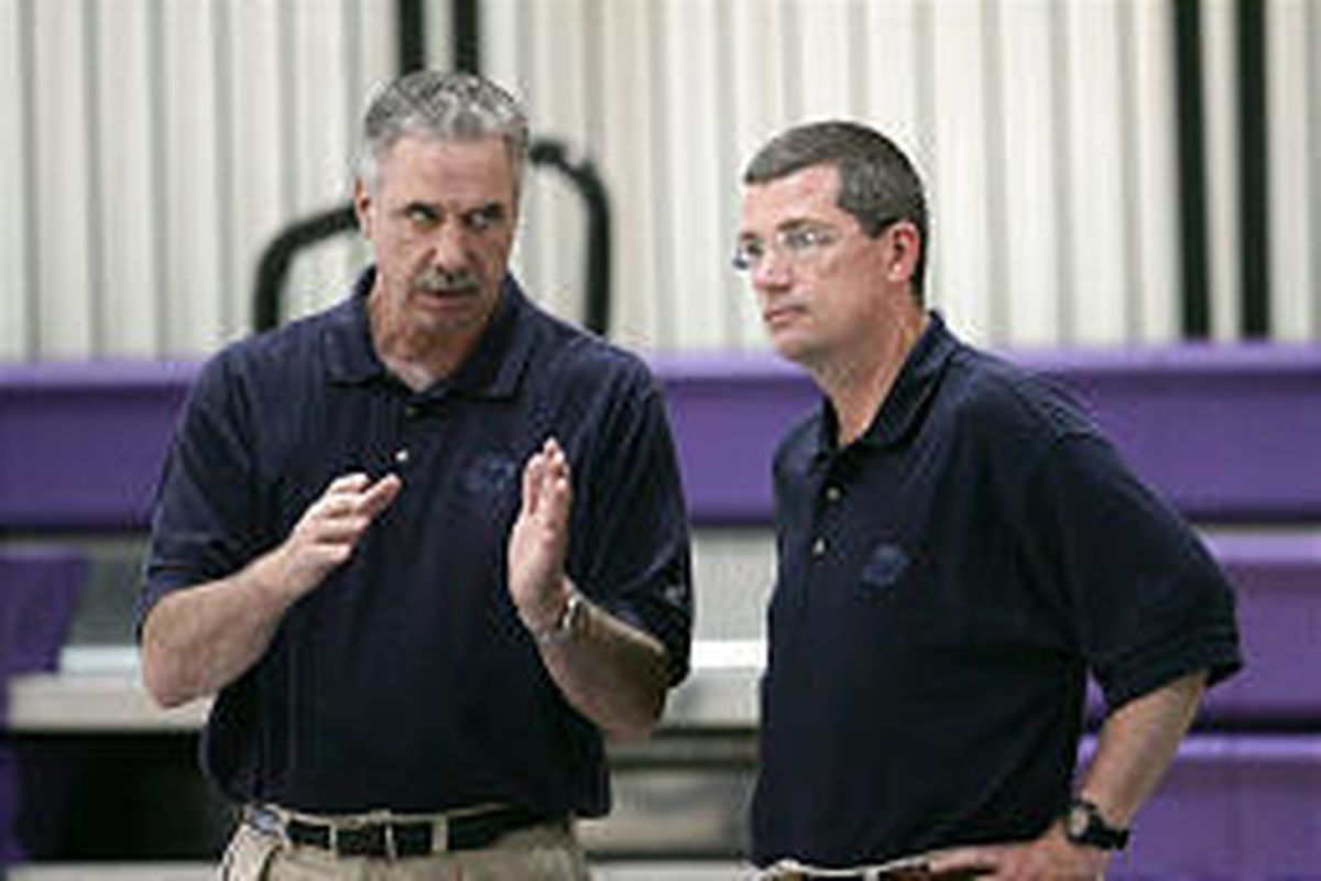 Jazz coaches Phil Johnson, left, and Scott Layden have a conversation during a summer practice.