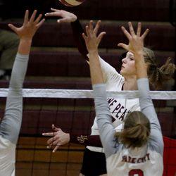 Lone Peak's Lauren Jardine (17) hits the ball against Park City's Mattie Prior (2) at Lone Peak High School in Highland on Wednesday, Aug. 26, 2020.
