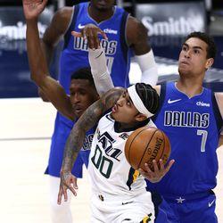 Utah Jazz guard Jordan Clarkson (00) flips up a shot as the Utah Jazz and the Dallas Mavericks play an NBA basketball game at Vivint Smart Home Arena in Salt Lake City on Wednesday, Jan. 27, 2021.