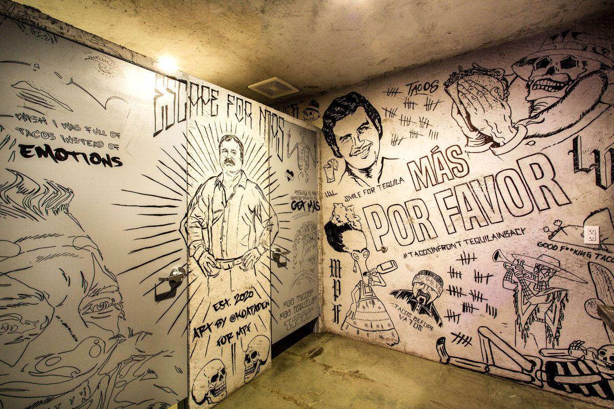 Graffiti art in the men's restroom at Más Por Favor Taqueria y Tequila