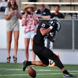 Highland High School's Ashton Olevao reacts to missing a long pass while he is open near the end zone during a game against Salem Hills in Salt Lake City on Friday, Sept. 13, 2019.