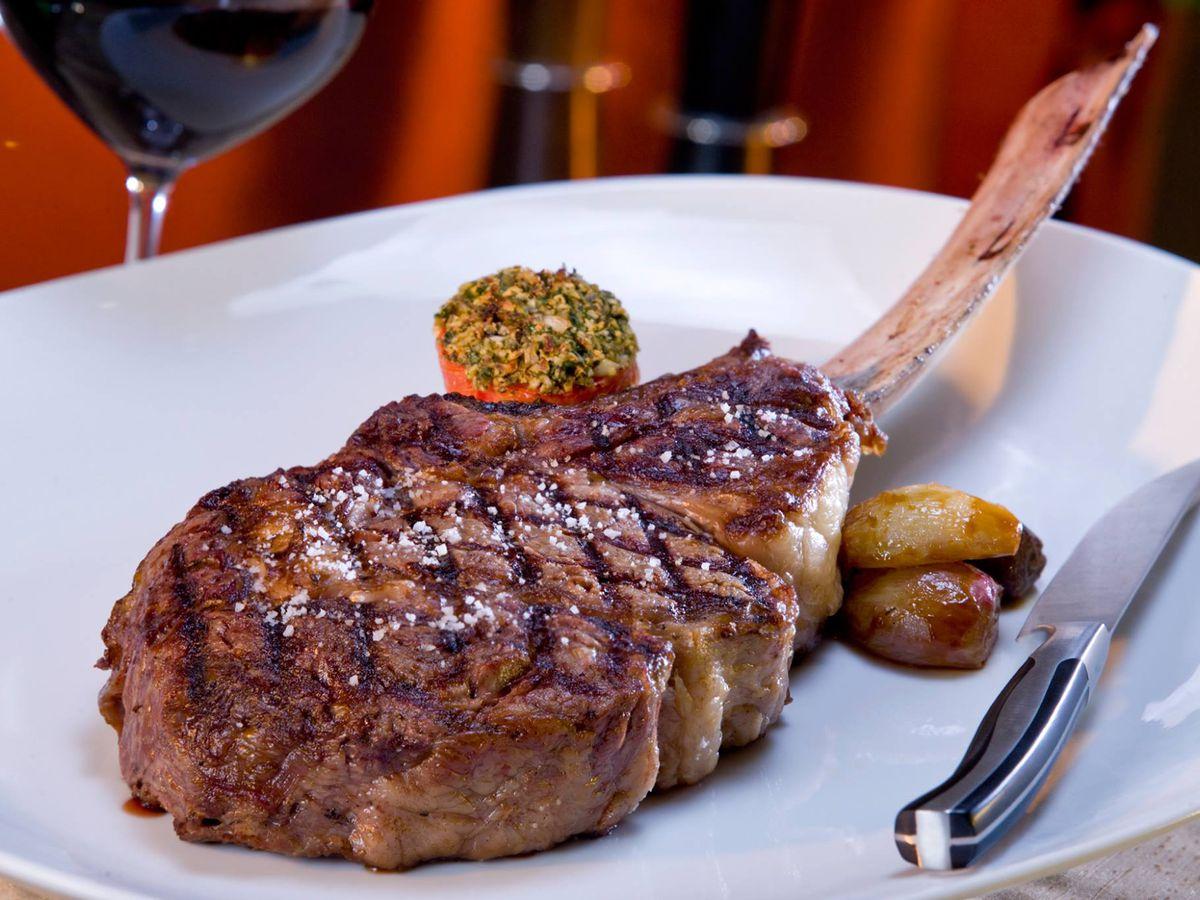Long bone grilled steak served with veggies
