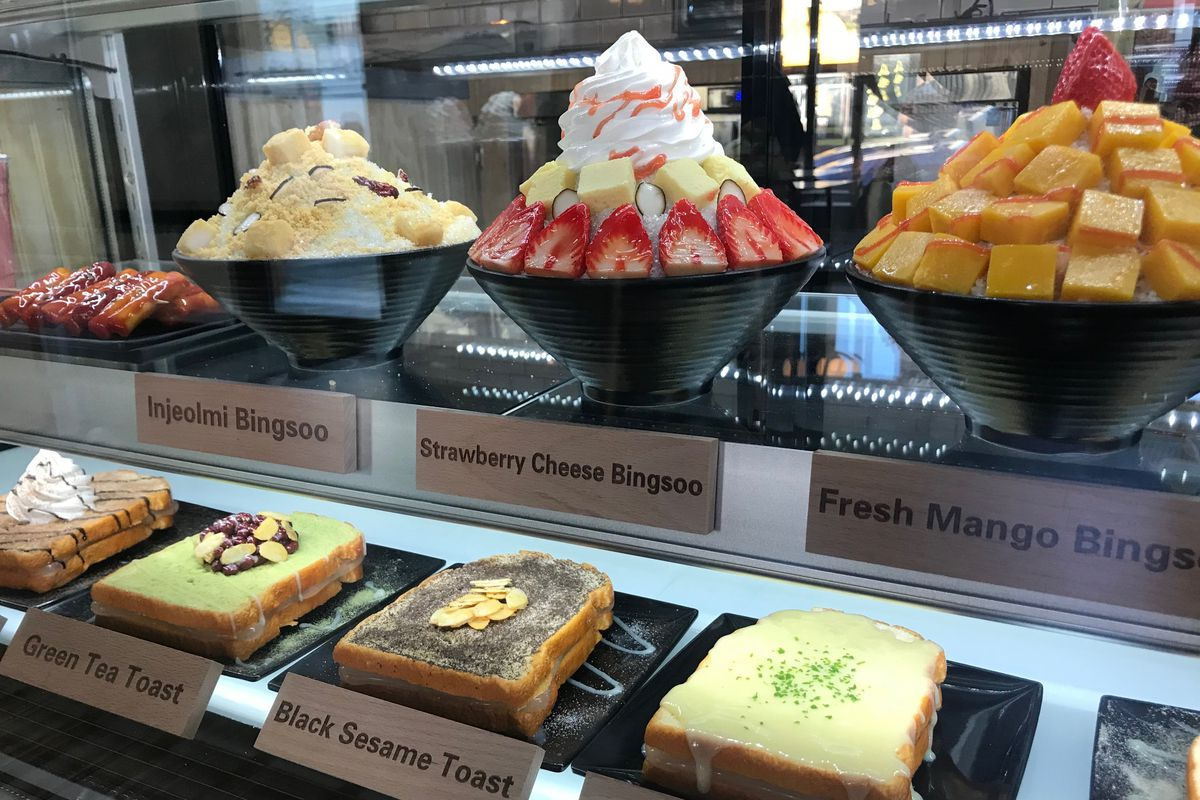 The display case at Milkie Milkie showing a selection of colorful bingsoo and toasts.