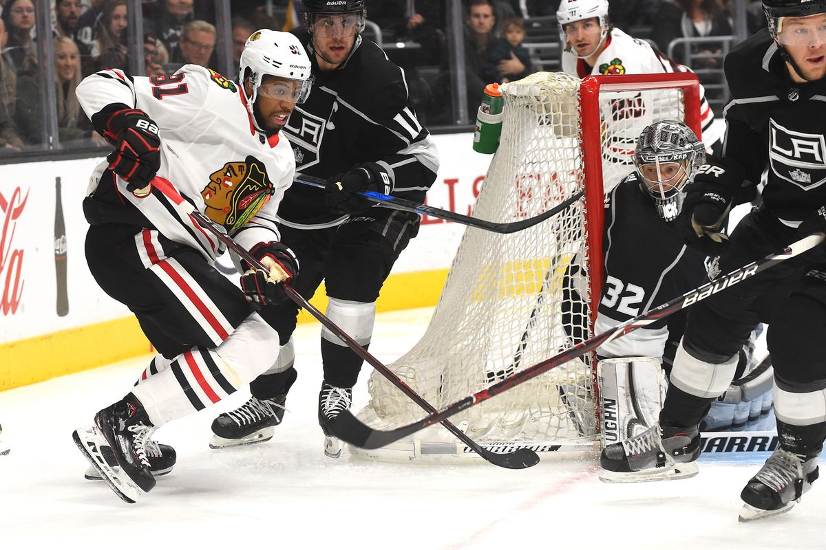 Mar 3, 2018; Los Angeles, CA, USA; Los Angeles Kings center Anze Kopitar (11) and Chicago Blackhawks left wing Anthony Duclair (91) chase down the puck as Los Angeles goaltender Jonathan Quick (32) defends the net in the third period at Staples Center.
