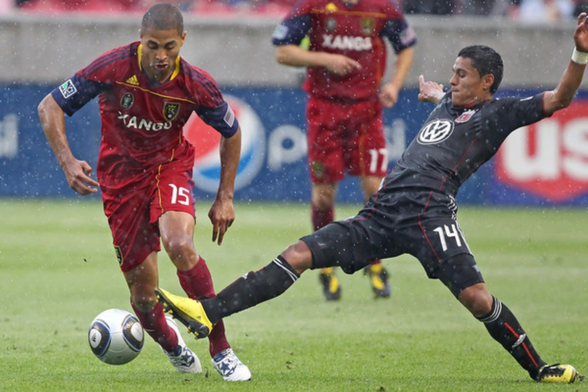 SANDY UT - JULY 31: Alvaro Saborio #15 of Real Salt Lake has the ball taken from him by Andy Najar #14 of DC United during the first half of an MLS soccer game July 31 2010 at Rio Tinto Stadium in Sandy Utah. (Photo by George Frey/Getty Images)