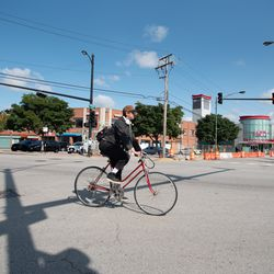 A cyclist crosses the street in the Chinatown neighborhood of Chicago, IL on July 27, 2018.   Colin Boyle/Sun-Times