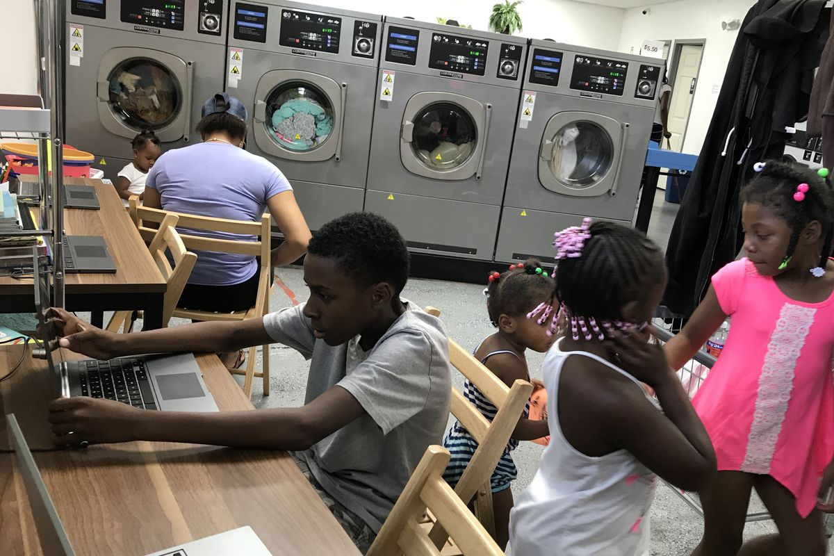 Children at Detroit's Fit and Fold laundromat now have computers to use and books to read while their parents do the wash — part of an effort to bring literacy programs to places where families are.