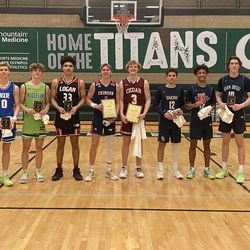 The 4A All-Stars pose with their plaques after Friday's coaches association all-star games at Olympus High School.