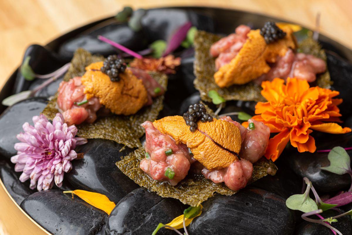 A5 yukhoe with uni and caviar on crispy Korean seafood crisps.
