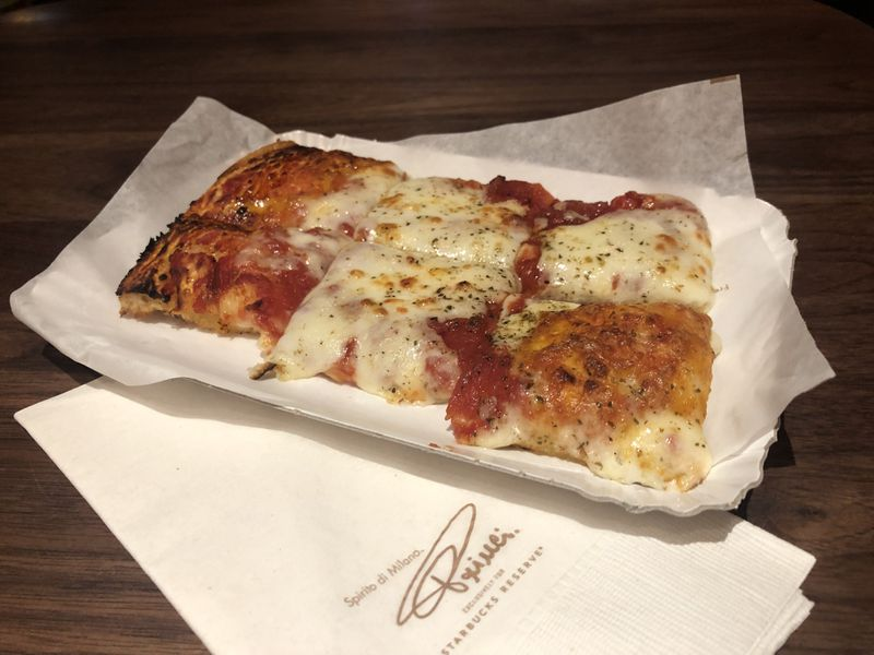 The $8.50 margherita pizza slice at Starbucks Reserve