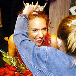 Lindsey Smith, the newly crowned Miss Murray, has her tiara straightened by her friend Abby Hawkins after the pageant is over. The Miss Murray pageant took place at Murray High School on Sept. 17, 2005. Many local pageants hold workshops for contestants and teach interviewing and public-speaking skills.