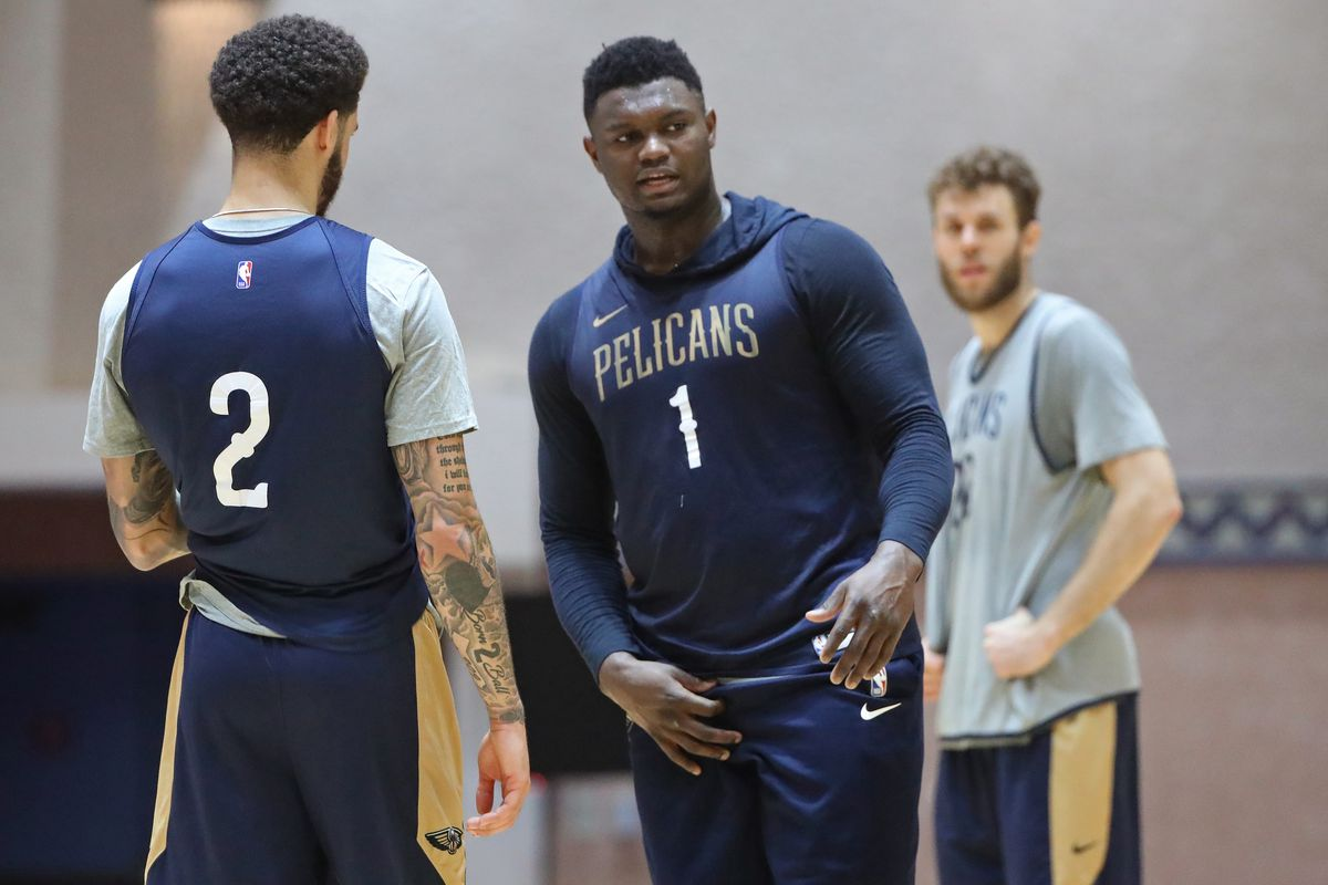 Zion Williamson and Lonzo Ball of the New Orleans Pelicans talk during practice as part of the NBA Restart 2020 on July 13, 2020 in Orlando, Florida.