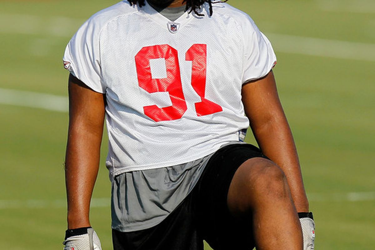 FLOWERY BRANCH GA - JULY 30:  Corey Peters #91 of the Atlanta Falcons stretches during opening day of training camp on July 30 2010 at the Falcons Training Complex in Flowery Branch Georgia.  (Photo by Kevin C. Cox/Getty Images)
